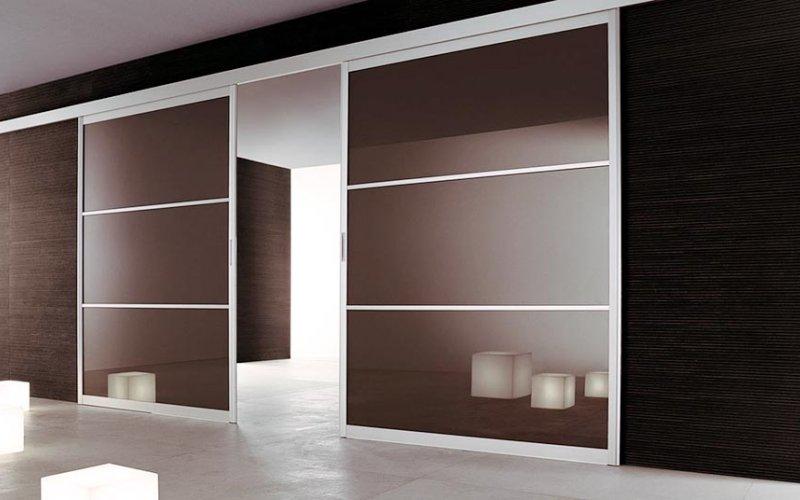 Межкомнатные раздвижные двери со стеклом